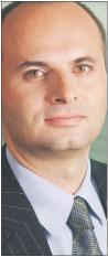 Krzysztof Piglowski, dyrektor w firmie doradczej Ernst & Young